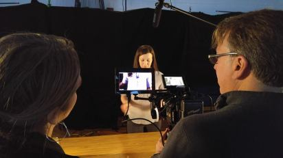 "Director of Photography Gil Whitney and Director Steph Greegor discuss lighting as they film actress Dianna Craig on te set of ""Magic"" for Water for Good public service announcement."